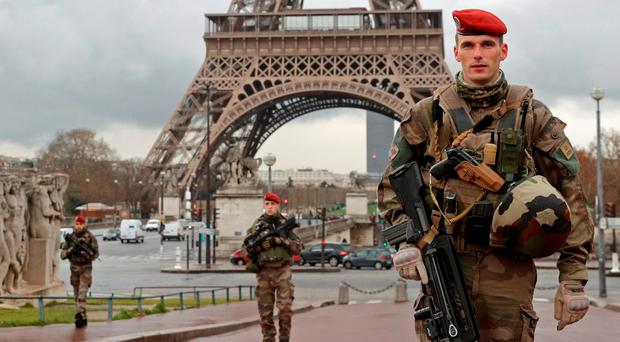Soldiers patrol near the Eiffel Tower in Paris. Photo: Reuters