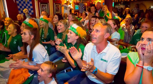 Supporters of Thomas Bar, including his sister Becky, watch the race at the Cove Bar in Waterford city yesterday. Photo: Patrick Browne