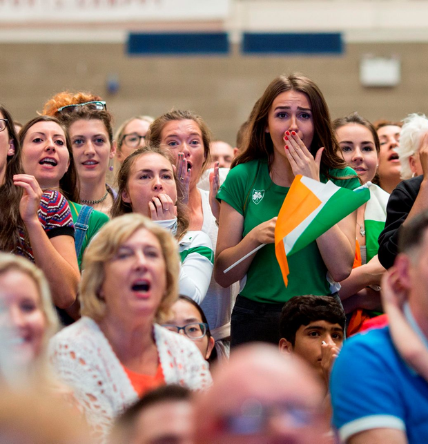 Sharlene Mawdsley (in green) reacts during the race as fans in UL watch the final. Photo: Alan Place
