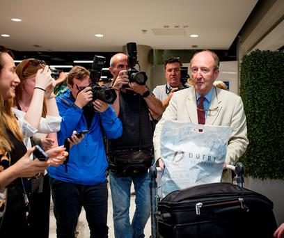 Minister for Tourism and Sport Shane Ross arriving home at Dublin Airport yesterday. Photo: Arthur Carron