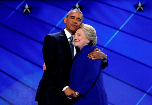 US President Barack Obama hugs Democratic Presidential candidate Hillary Clinton after addressing the delegates at the Democratic National Convention in Philadelphia, in July. Photo: Carolyn Kaster