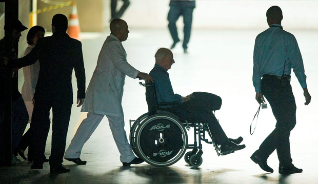 Patrick Hickey leaves the Hospital Samaritano Barra in a wheelchair. Photo: Sportsfile
