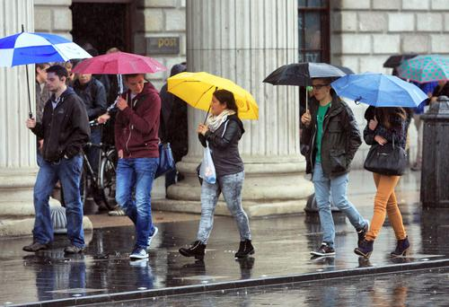 Dealing with raining in Dublin city centre. File picture