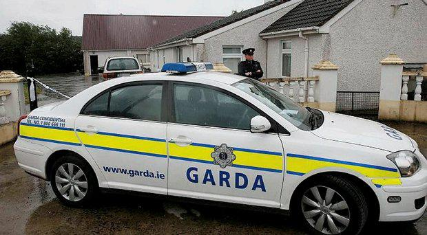 Gardai outside a house in Castletown, Kilpatrick, near Navan, Co Meath, which has been sealed off as six people have been arrested after a man alleged he was being falsely imprisoned at the property