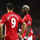 MANCHESTER, ENGLAND - AUGUST 19: Paul Pogba of Manchester United talks to Zlatan Ibrahimovic during the Premier League match between Manchester United and Southampton at Old Trafford on August 19, 2016 in Manchester, England. (Photo by Michael Steele/Getty Images)