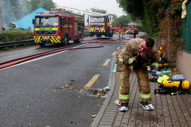 A firefighter cleans himself down after fire in Lisdoonvarna. Picture Credit Press 22