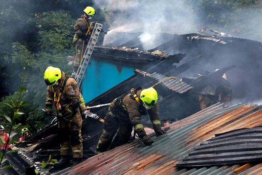 Firefighters on the roof of the building. Picture Credit Press 22