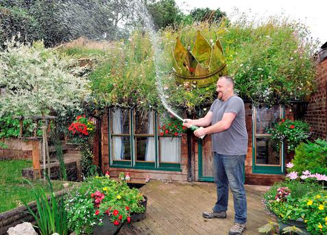 Father-of-four Kevin Herbert has quietly lifted one of the nation's most coveted titles - that of shed of the year. Cuprinol/PA Wire