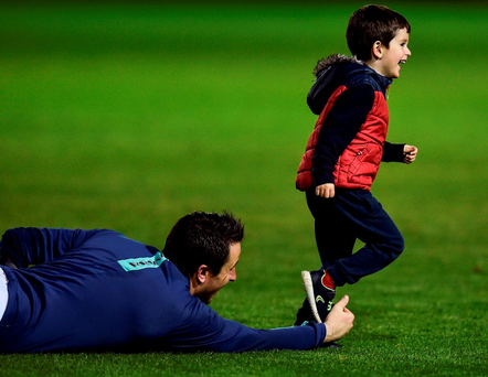 Brendan Clarke and his four-year-old son, Zac, in Richmond Park after last night's victory Photo: David Maher/Sportsfile