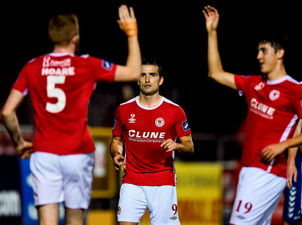 Christy Fagan (centre) of celebrates after scoring the second goal for St Patrick's Athletic Photo: David Maher/Sportsfile