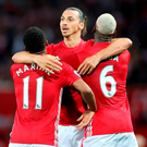 Zlatan Ibrahimovic (centre) celebrates scoring his side's first goal of the game with team-mates Paul Pogba (right) and Anthony Martial Photo: Nick Potts/PA Wire