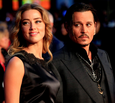 Amber Heard and Johnny Depp, who settled their contentious divorce on Tuesday Photo: Jonathan Brady/PA Wire