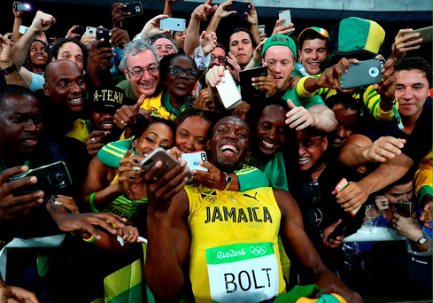 Usain Bolt celebrates with supporters after winning the men's 200metres gold medal Photo: Ryan Pierse/Getty Images