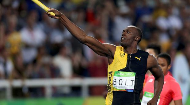 Usain Bolt (JAM) of Jamaica celebrates winning the gold. REUTERS/Ueslei Marcelino