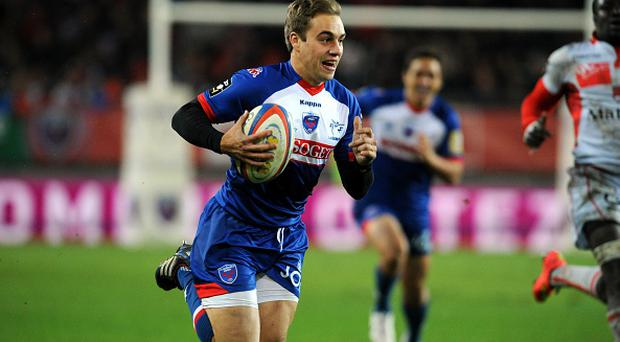 Grenoble's Irish scrum-half James Hart runs with the ball during the French Top 14 rugby union match Grenoble (FCG) vs Lyon (LOU) on November 8, 2014 at the Stade des Alpes in Grenoble. AFP PHOTO / Jean-Pierre Clatot. (Photo credit should read JEAN-PIERRE CLATOT/AFP/Getty Images)