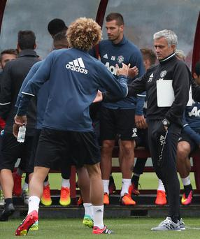 MANCHESTER, ENGLAND - JULY 28: (EXCLUSIVE COVERAGE) Manager Jose Mourinho and Marouane Fellaini of Manchester United in action during a first team training session at Aon Training Complex on July 28, 2016 in Manchester, England. (Photo by John Peters/Man Utd via Getty Images)