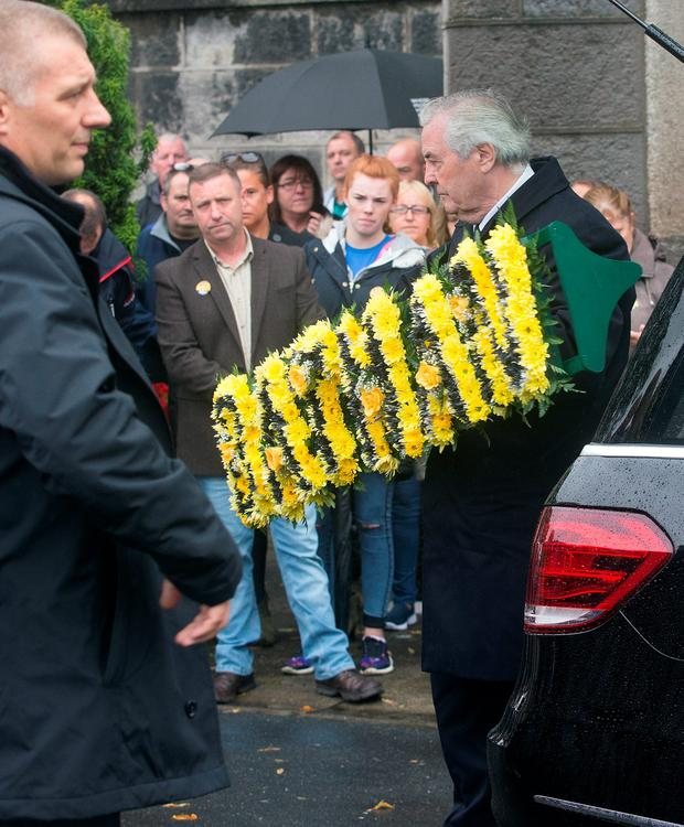 A Batman floral wreath at the funeral of Ben Farrell, 'Batman Ben' at the Church of the Sacred Heart in Arbour Hill. Photo: Tony Gavin
