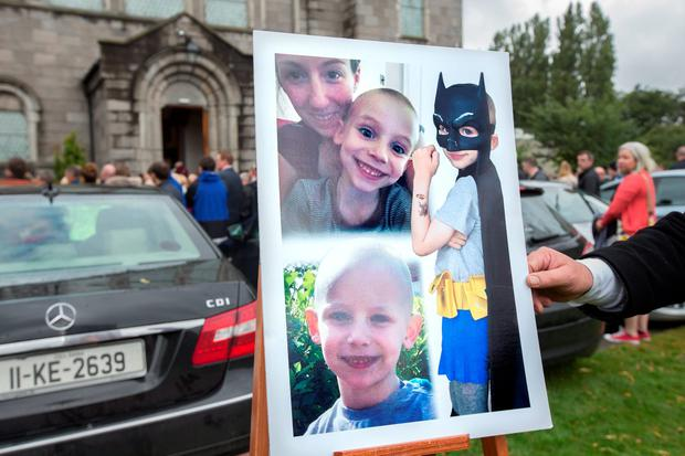 photos are displayed at the funeral of Ben Farrell, 'Batman Ben' at the Church of the Sacred Heart in Arbour Hill. Photo: Tony Gavin