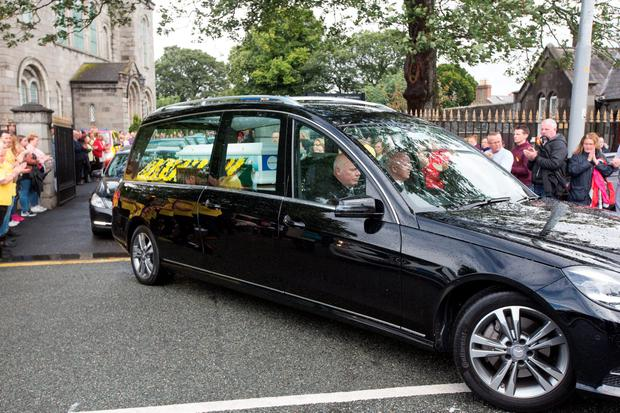 The hearse leaves the funeral of Ben Farrell, 'Batman Ben' at the Church of the Sacred Heart in Arbour Hill. Photo: Tony Gavin