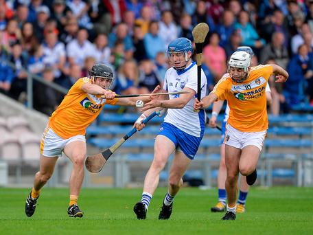 Austin Gleeson of Waterford in action against Cormac Ross, left, and Maoi Connolly of Antrim