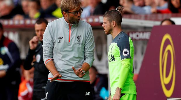 Liverpool manager Juergen Klopp speaks with Alberto Moreno