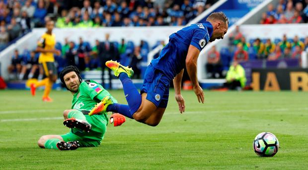 Leicester City's Danny Drinkwater goes down in the area after a challenge from Arsenal's Laurent Koscielny (not pictured)