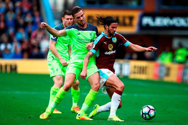 Liverpool's Jordan Henderson and Burnley's George Boyd vie for possession. Photo: Getty