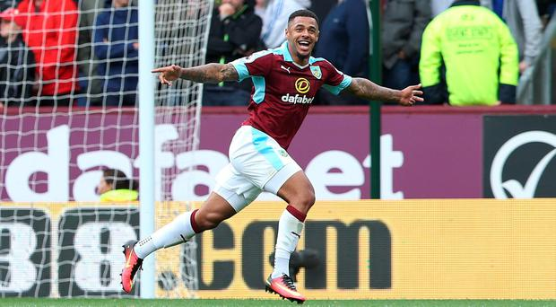 Burnley's Andre Gray celebrates scoring his side's second goal against Liverpool at Turf Moor yesterday. Photo: Reuters