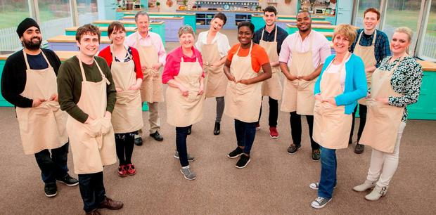READY TO CRUMBLE: From left, Rav, Tom, Kate, Lee, Val, Candice, Benjamina, Michael, Selasi, Jane, Andrew and Louise — contestants for this year's 'Great British Bake Off'. Photo: Mark Bourdillon/PA