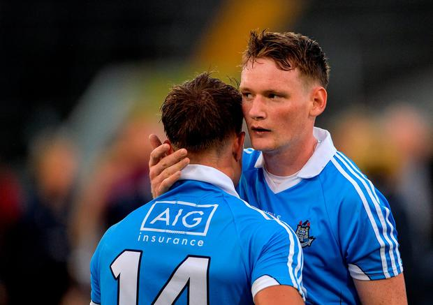 Cian Boland of Dublin, left is consoled by team mate Shane Barrett