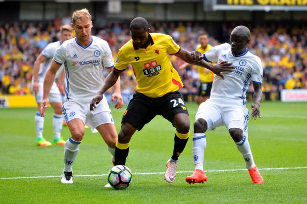 Watford's Odion Ighalo attempts to hold off Chelsea's N'Golo Kante and Branislav Ivanovic Photo: Reuters / Hannah McKay