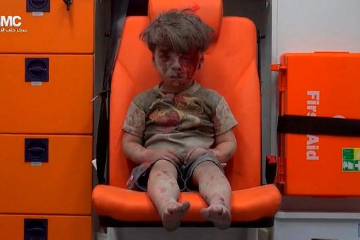 HORROR: Three-year-old Omran Daqneesh sits in an ambulance after being pulled out of a building hit by an airstirke in Aleppo, Syria, last Wednesday. (Aleppo Media Center via AP)