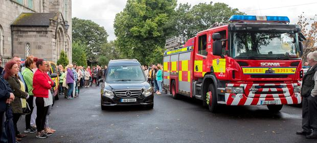 SUPERHERO: The hearse leaves the funeral of Ben Farrell, known as 'Batman Ben', flanked by a fire engine at the Church of the Sacred Heart in Arbour Hill. Photo: Tony Gavin