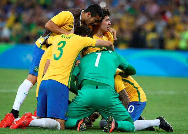 Neymar, Weverton and Rodrigo Caio of Brazil celebrate victory