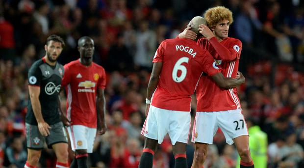 Manchester United's Paul Pogba with Marouane Fellaini