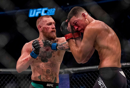 20 August 2016; Conor McGregor of Ireland in action against Nate Diaz of USA during their welterweight bout at UFC 202 in the T-Mobile Arena, Las Vegas, USA. Photo by Joshua Dahl/Sportsfile