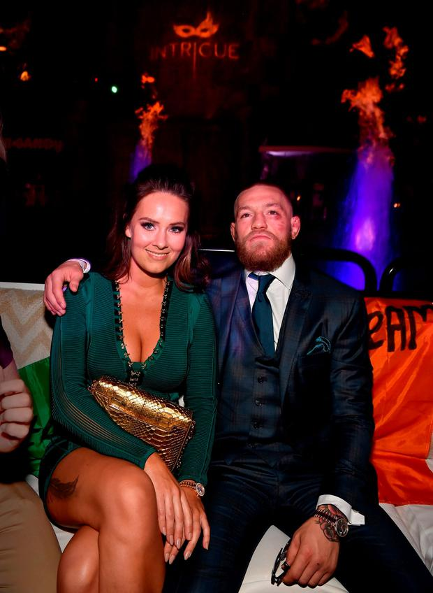 Mixed martial artist Conor McGregor and Dee Devlin celebrate his UFC 202 victory