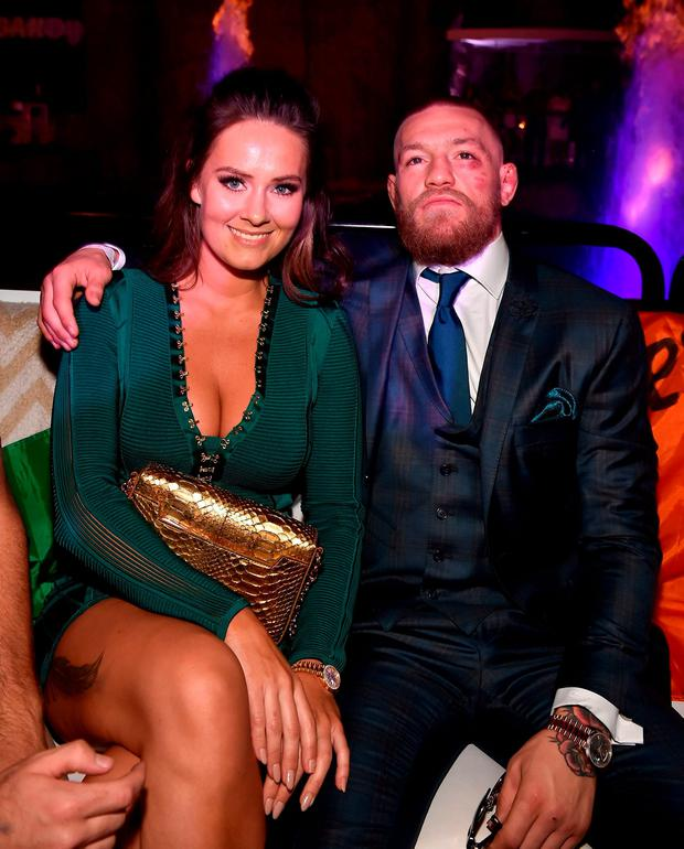 Conor McGregor and girlfriend Dee Devlin celebrate his UFC 202 victory during the official after-fight party at Intrigue Nightclub at Wynn Las Vegas
