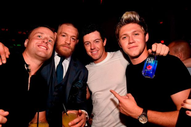Niall Horan and Rory McIlroy celebrate with Conor McGregor UFC 202 victory during the official after-fight party at Intrigue Nightclub at Wynn Las Vegas