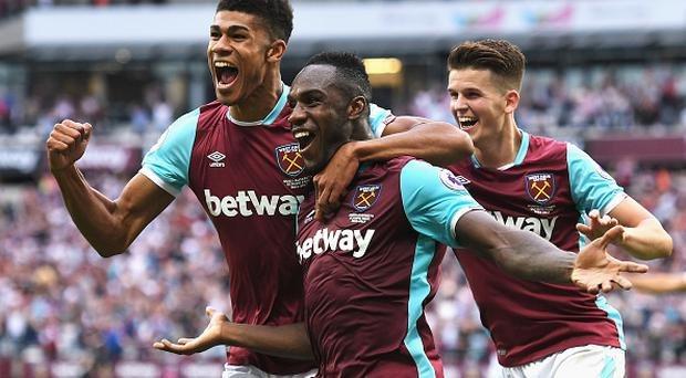 LONDON, ENGLAND - AUGUST 21: Michail Antonio (C) of West Ham United celebrates scoring the opening goal with team mates Ashley Fletcher (L) and Sam Byram during the Premier League match between West Ham United and AFC Bournemouth at London Stadium on August 21, 2016 in London, England. (Photo by Michael Regan/Getty Images)