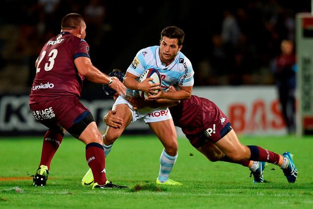 Racing Metro 92 French fullback Brice Dulin is tackled. Photo: Nicolas Tucat/GettyImages