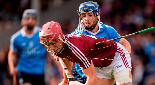 Seán Treacy attempts to hook the sliotar away from Galway's Declan Cronin in Thurles. Photo: Sportsfile