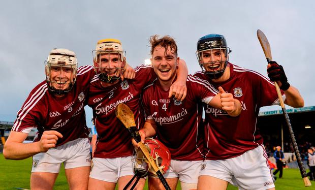 Galway players, from left, Darragh Dolan, Conor Jennings, Declan Cronin and Seán Loftus celebrate. Photo: Sportsfile