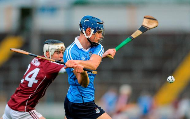 Eoghan O'Donnell of Dublin in action against Aiden Helebert of Galway. Photo: Sportsfile