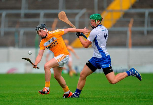 James O'Connell of Antrim in action against Tom Devine. Photo: Sportsfile