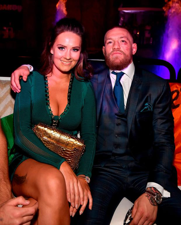 McGregor relaxes with his girlfriend Dee Devlin following the fight Photo: David Becker/Getty Images for Wynn Las Vegas