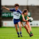 Kate O'Sullivan of Kerry comes under pressure from Monaghan's Cora Courtney. Photo: Sportsfile