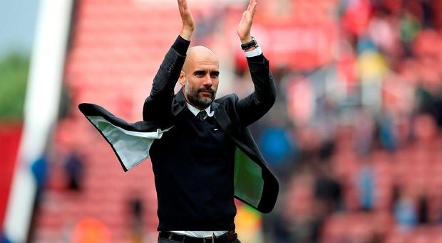 Manchester City's Pep Guardiola appauds the fans. Photo: PA