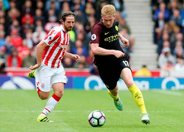 Manchester City's Kevin De Bruyne in action with Stoke City's Joe Allen. Photo: Reuters