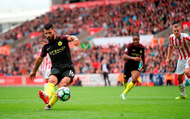 Manchester City's Sergio Aguero scores his side first goal of the match from the penalty spot. Photo: PA